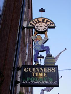 Guiness Time at Foley's Neon Sign & Clock. Dublin, Ireland.