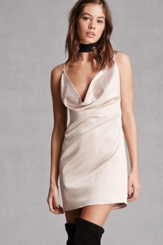 A satin mini dress featuring a low cowl neck, adjustable cami straps that crisscross in the back, a scoop back, and an invisible side zipper. This is an independent brand and not a Forever 21 branded item.