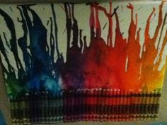 Hot glued crayons to a canvas boarh then used blow dryer on high and hot woooozzaa that was pretty easy