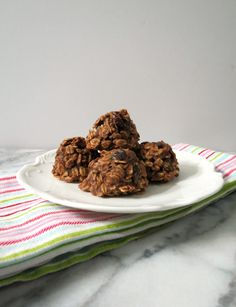 Chocolate Almond Cranberry Breakfast Cookies - A healthy, all natural, gluten free, vegan chocolate oatmeal cookie that is slightly crunchy on the outside, soft in the middle and made with almond nut butter and cranberries.  Only 60 calories a cookie!
