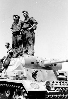Soldiers of the Wiking Division watch the planes of the Luftwaffe, probably bringing fuel, during Operation Blue in the summer of 1942. Their tanks is a Panzer III armed with a 50mm gun and bears the 'Wiking' Division badge.