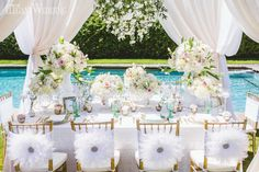 White feathery draped wedding table setting, feather chair covers, white and pink wedding centerpieces/centrepieces, place setting, poolside wedding ELEGANT PASTEL POOLSIDE WEDDING INSPIRATION www.elegantwedding.ca