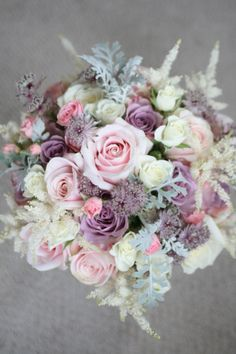 Wedding bouquet in vintage colours with roses, spray roses, astrantia, astilbe and senecio foliage. Liberty Blooms