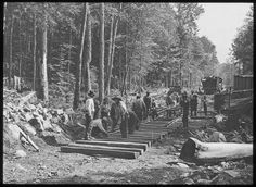 Laying a railroad through the Adirondacks, c1913. #history http://historicalphotographs.net/