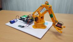 DIY Arduino & Bluetooth Controlled Robotic Arm Project with Circuit Diagram & Output Engineering Projects, Arduino Projects, Arduino Robot Arm, Homemade Robot, Arduino Bluetooth, Techno Gadgets, Rc Robot, Electrical Projects, Hardware Software