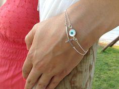 Evil eye bracelet Silver sideways cross & by JewelryFamousWorld