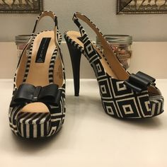 Steven Textile Chevron Slingback With Bow Steven by Steve Madden Carolyn slingback.   Textile upper with black and white rectangle pattern.  Faux leather bow with gunmetal detail.  5 inch heel 1 inch platform.   Excellent used condition. Steven by Steve Madden Shoes Heels