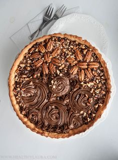 """Paleo Chocolate Pecan Tart Today is Father's Day and for me it obviously means baking and spending quality time with my loved ones.  This recipe here for the chocolate pecan tart is paleo, gluten and sugar free. Basically I put together two of my recipes """"Strawberry Tart"""" and """"Raw Vegan Mini Choclate Pecan Tart"""". The tart crust is made with almond meal."""
