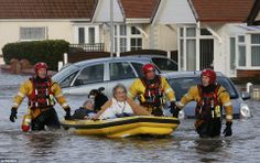 Following the heavy wind and rain that has hit much of the UK and causes flooding and tidal surges, the #lightrevolution has shone as people reach out and help one another.  Here emergency rescue service workers are evacuating residents in Rhyl, North Wales. Let's thank God for the efforts of the emergency services, many of whom have worked through the night to make sure people are brought to safety.