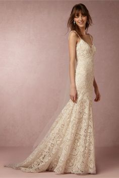 This breathtaking wedding gown feels straight out of the pages of a storybook with its scalloped lace, iridescent sequins and sweeping train.