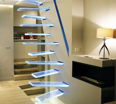 "French interior designer Frédéric Hamerlak created this striking illuminated glass staircase with an unusual zigzag pattern. ""Each tread of the staircase comes with built-in LED… Modern Staircase, Grand Staircase, Staircase Design, Architecture Design, Escalier Design, Appartement Design, Interior Stairs, French Interior, Deco Design"