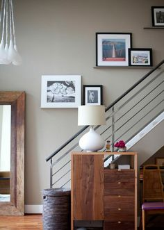 Apartment 34 | The Loft Life 2.0: Revealed!  Love the pictures going up the stairs on small shelves
