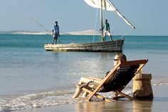 Relaxing sundowners after a safari in a traditional dhow