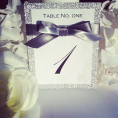 Silver ribbon & glitter table number great for weddings, sweet sixteens, birthdays, engagements parties, and other events.. via Etsy.