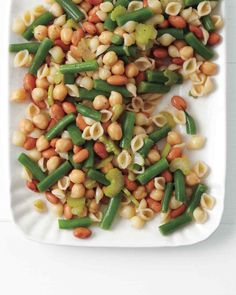 Three-Bean Pasta Salad.     Salt and pepper,     6 ounces small pasta shells,     3/4 pound green beans trimmed and cut into thirds,     2 tablespoons Dijon mustard,     1/3 cup red-wine vinegar,     2 tablespoons honey,     1/2 cup extra-virgin olive oil,     1 can (15.5 ounces) pinto beans rinsed and drained,     1 can (15.5 ounces) chickpeas rinsed and drained,     4 scallions (white parts only) thinly sliced,     5 stalks celery thinly sliced