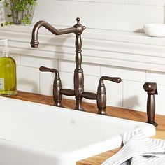 Gorgeous faucet via DXV for a traditional kitchen!