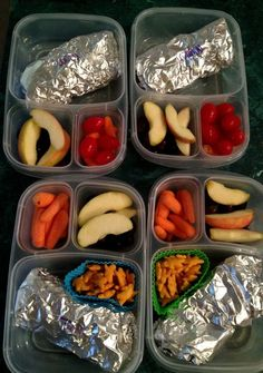Lunchbox burritos, grapes & apple slices, carrots & grape tomatoes. Brady and Ches don't do tomatoes so they got Cheddar Bunnies with their burrito.