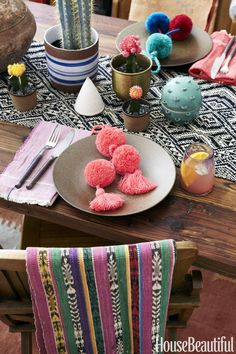This is the scene when Lizzie and Kathryn Fortunato, the twins behind the boho-chic Lizzie Fortunato fashion and home accessories line, throw a laid-back dinner party inspired by a trip to Sayulita, Mexico. Mixing hues that don't usually go together, like pink and red, feels playful. Warm metals lend a touch of glamour and complement all the neutrals. Tassels provide texture and double as party favors. Click through for more on this fall fiesta tablescape.