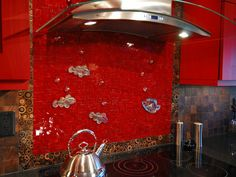 """The backsplash is the blank canvas of the kitchen,"" says John Ryba, who designed this unique aquarium-inspired backsplash with three-dimensional glass fish and bubbles. ""It's an opportunity to add color, function and harmony to the overall design."""