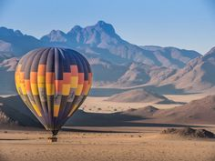 Experience the best of Namibia on a sunrise hot air balloon ride over the world's oldest desert, Namib desert. After soaring the skies and witnessing endless oceans of sand, mountains and the shadows of the Sossusvlei, land in the middle of nowhere for a scrumptious breakfast with champagne to toast this the unforgettable experience. #explorer #explorersafari #travel #exploreafrica #hotairballoon #africa #bucketlist #experience #adventure #exploreafrica #namibia #desert #views #namibdesert Balloon Rides, Hot Air Balloon, Africa Destinations, Namib Desert, Africa Travel, Oceans, Shadows, Safari, Places To Go