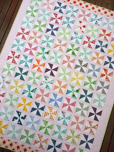 DARLING little pinwheel quilt!  I love the the white with red polka dot sashing!  $8.50