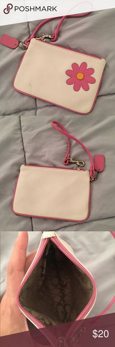 Coach Flowered Wristlet Coach wristlet. White with pink flower design. Zipper closure. Never used, but there's a small green smudge on the front (pictured). Coach Bags Clutches & Wristlets