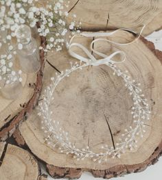 Babys Breath This beautiful headpiece has been crafted out of silver plated wire and is adorned with freshwater pearls, Swarovski pearls and Swarovski crystals. Satin ribbons are attached to tie the piece to the head, however they are easily removed to allow for pinning into the