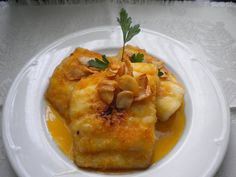 Bacalao a la llauna con pimentón dulce. Ver receta: http://www.mis-recetas.org/recetas/show/16726-bacalao-a-la-llauna-con-pimenton-dulce