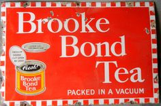 Red rectangle sign advertising Brooke Bond Tea showing a container of the company's product.