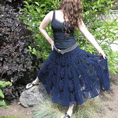 Versatile crocheted design by Flora Yang.  Wear it as a skirt or poncho.