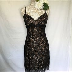 """BCBG MAXAZRIA // Floral Lace Dress - black Impress at date night with this sexy lace dress from BCBG MAXAZRIA. Features a nude slip and scalloped hemline. Has been worn but still in great condition. Size has worn off. Measurements are bust 32"""", waist 28"""", hips 36"""", length 24"""" from bust to hemline. BCBGMaxAzria Dresses Mini"""
