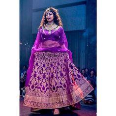 Actress Pranitha Subash struts down the runway in custom Benarasi handloom #lehenga #lehengacholi #actresses #pranithasubash #handloom #benarasi #purple #ultraviolet