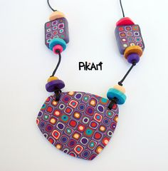 Colorful handmade polymer clay necklace - purple, turquoise, pink, gold. €16,90, via Etsy.