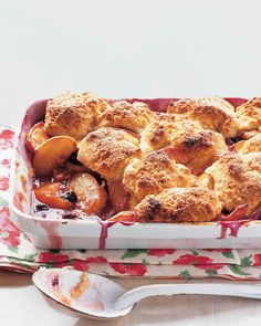 Fresh peaches and blueberries are baked beneath a fluffy layer of vanilla-cream biscuits. The tops are brushed with heavy cream and sprinkled with sanding sugar for a crispy-sweet crunch. When Martha made this recipe on Martha Bakes episode 301, she omitted the blueberries.