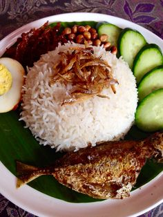 "Creamy & fragrant coconut rice with its side dishes, famous asian street food. ""Nasi Lemak"""