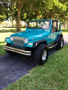 1997 Teal Jeep Wrangler. Mickey Thompson Classic iii wheels. Factory Bright Jade paint.
