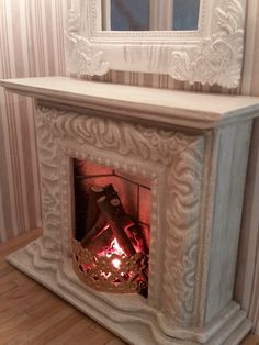 miniature fireplace made from a picture frame