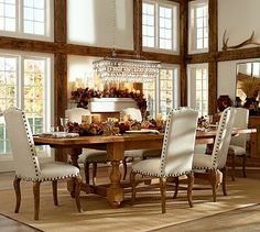 Cortona Extending Dining Table…LOVE THOSE AWESOME WHITE CHAIRS WITH THE NAIL-HEADS!!!