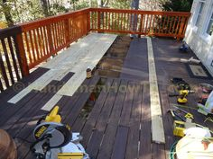 How to Replace Wood Deck Boards: Remove the old deck boards in sections and install new boards to rebuild the deck with photos.