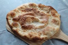 I was looking for an easy way to make the large Yemeni khobz without the round drum over (tanour or maskhan). This is the recipe I came up with which uses a bread stone and a wooden peel inside of a regular oven. Alas, its not exactly the same, but the bread did come close. I think it bubbled up a bit too much and could have been thinner, so maybe next time I would use less yeast. I used regular bread flour because thats all I had on hand, but I would recommend experimenting with maybe a…