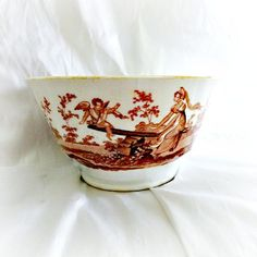 Early English staffordshire porcelain bat printed transferware bowl in orange of cupid with lady. Lusterware trim on edge, circa 1820 measures