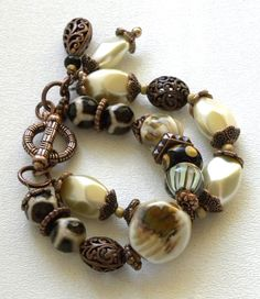 Love the colors in this for a diy bracelet - Multi Strand Ceramic Handmade Beaded by bdzzledbeadedjewelry, $29.00