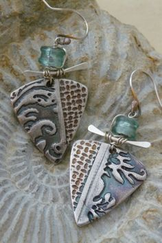 "Silk Road earrings Hand formed .999 silver earrings, kiln fired, carefully patinated. Lampwork glass from Germany, finished with wirework, hammered work, and ear wires all handmade with sterling silver. 1.25"" H x 0.75"" W $115.00"