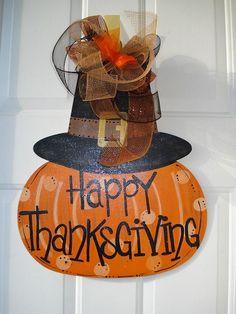 Happy Thanksgiving pumpkin with pilgram hat personalized door decoration hanger porch sign. $35.00, via Etsy.