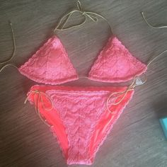 Victoria's Secret Swimsuit Victoria's Secret swimsuit. Triangle top is a size large and bottoms are a medium. Suit is in perfect condition! Crochet detail. Top has padding that can be removed. Victoria's Secret Swim Bikinis