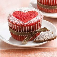 Red Velvet Cupcakes - Wear your heart on a decadent dessert. Red Velvet Cupcakes sport the color of the season. With a heart-shape cookie and a little powdered sugar, they're dressed for a party -- whether it's for two or more.