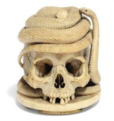 Skulls:  #Skull with snake, a German ivory Memento Mori, 19th century, 3¼ in. (8 cm.) high.