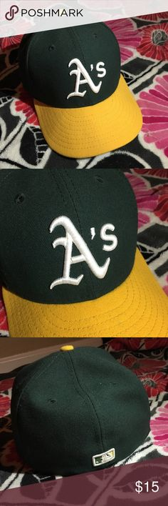 Oakland Athletics Hat Green and Yellow Oakland Athletics Hat. It has been worn a few times but kept in great condition. New Era Accessories Hats
