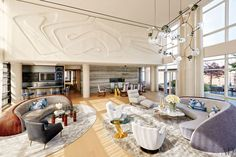 The Manhattan living room of entrepreneur Michael Hirtenstein features plaster relief by artist Malcolm Hill and a Lindsey Adelman chandelier.