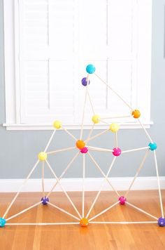 Encourage building skills and open-ended play with this easy and fun #DIY stick fort!